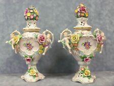 Von Schierholz Cherubic Lidded Urns Compote, A pair of