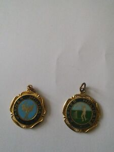 vintage warner award medals for tennis and one other.
