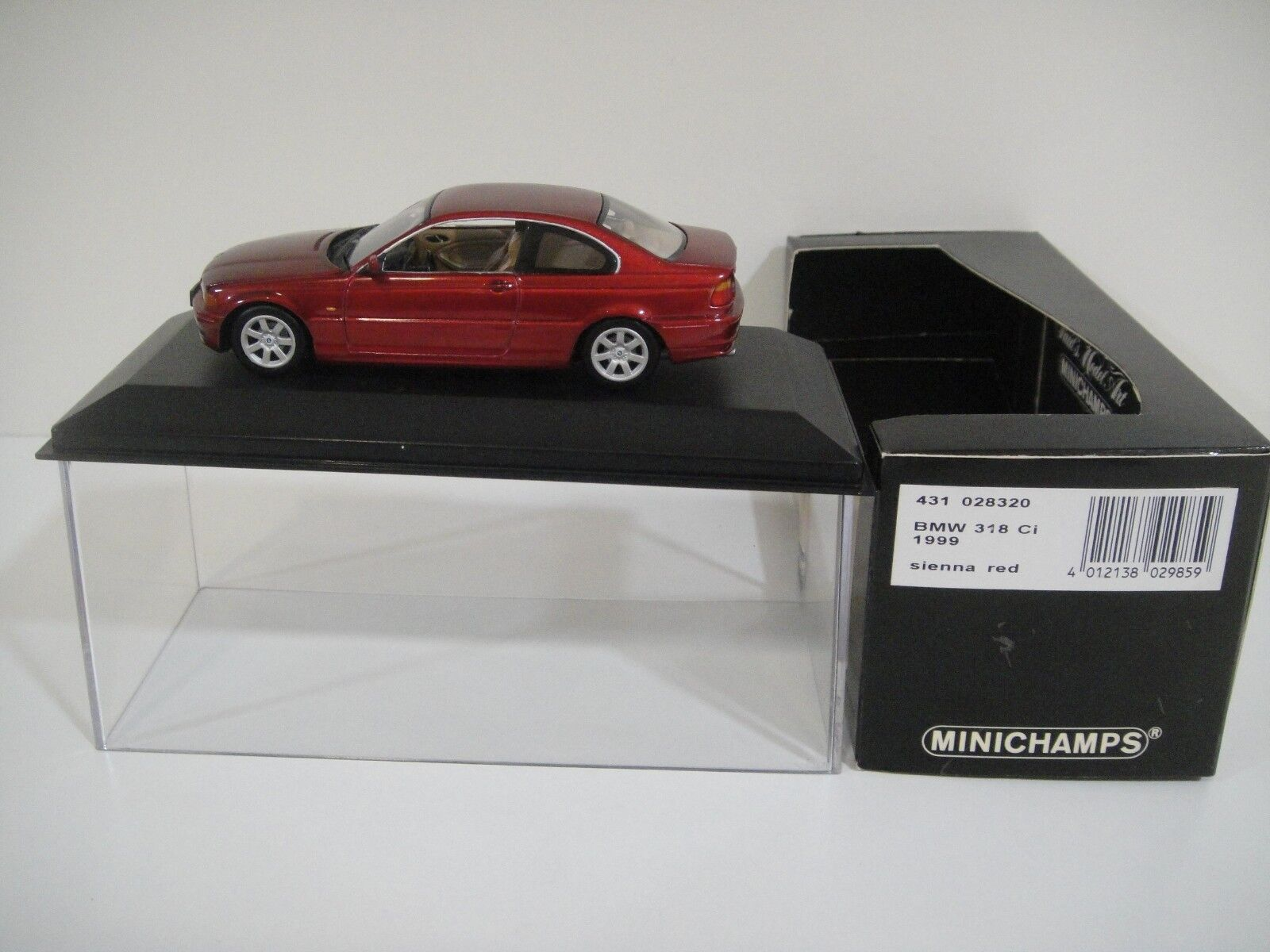 --1 43 MINICHAMPS. BMW 318 Ci. 1999 Sienna rouge.