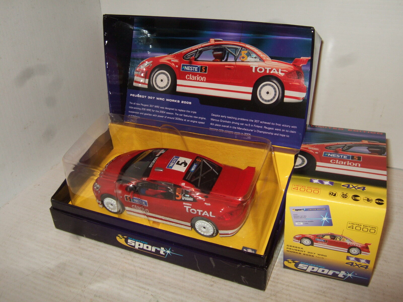 Scalextric C256A Gronholms Peugeot 307 GTA WRC Works 05 Slot Car with features.