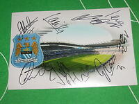 Manchester City Stadium Photograph Signed by the 2013/14 Squad - 9 Autographs!