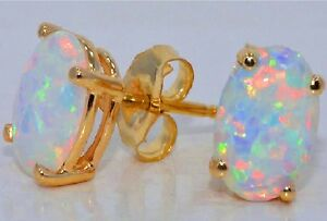 Opal Oval Shape 8x6mm Stud Earrings 14Kt Yellow Gold