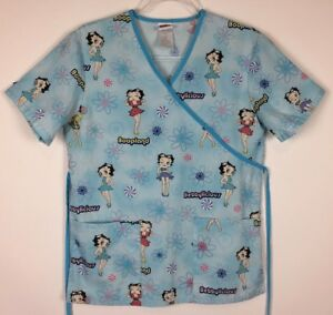 98493559e73 Betty Boop Scrub Top Size XS Blue Tie Back 2 Pocket Nursing Medical ...
