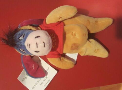 a Disney 8 Eeyore Dressed as Pooh Bean Bag Beanie NWT Winnie the Pooh Bear