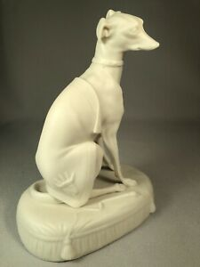 ANTIQUE-PARIANWARE-FIGURINE-OF-A-GREYHOUND-DOG-ON-CUSHION-WEARING-COAT-SUPERB