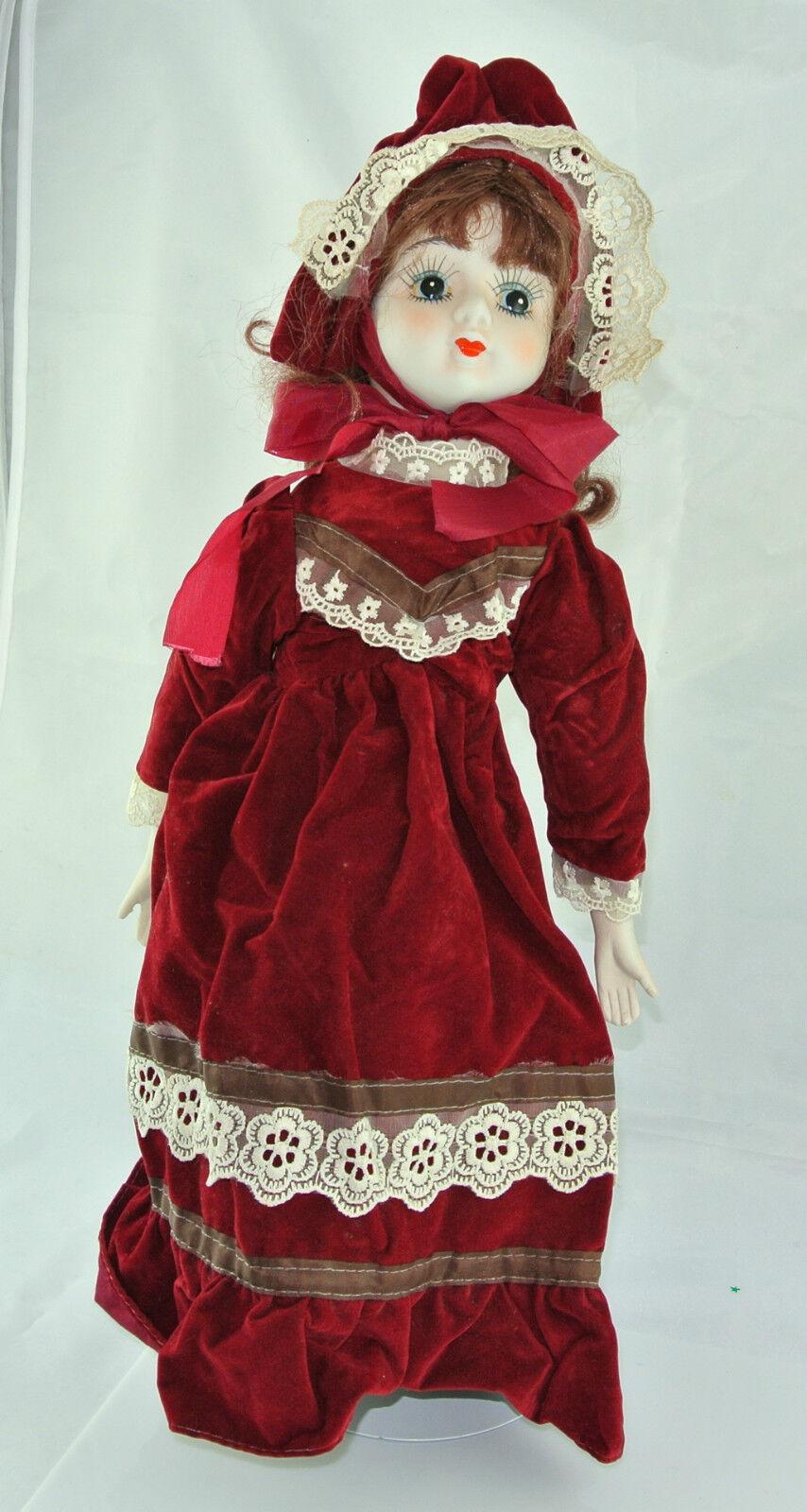 BAMBOLA con vestito rossoPORCELLANA testa & sostanza corpoca. 47 cm