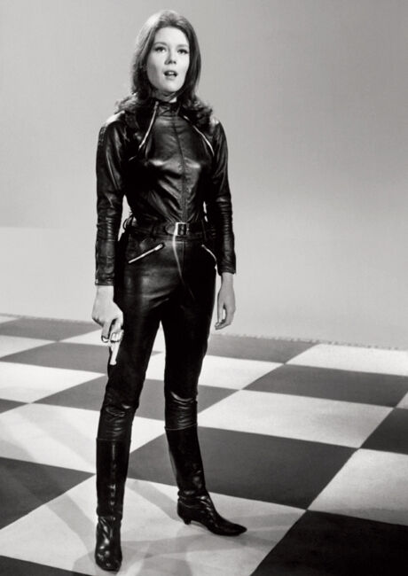 Woman in black leather suit with zippers