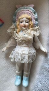 Vintage bisque Porcelain 5.5 in doll with string jointed arms fixed legs bonnet
