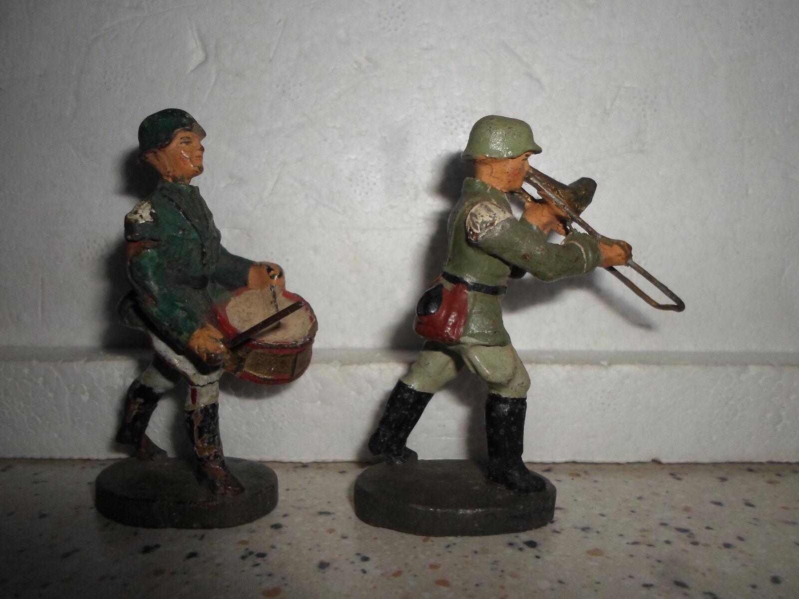 Före krigspkonstiet ELASTOLINOL marscherande tysk trummis och trombonsoldat WWII