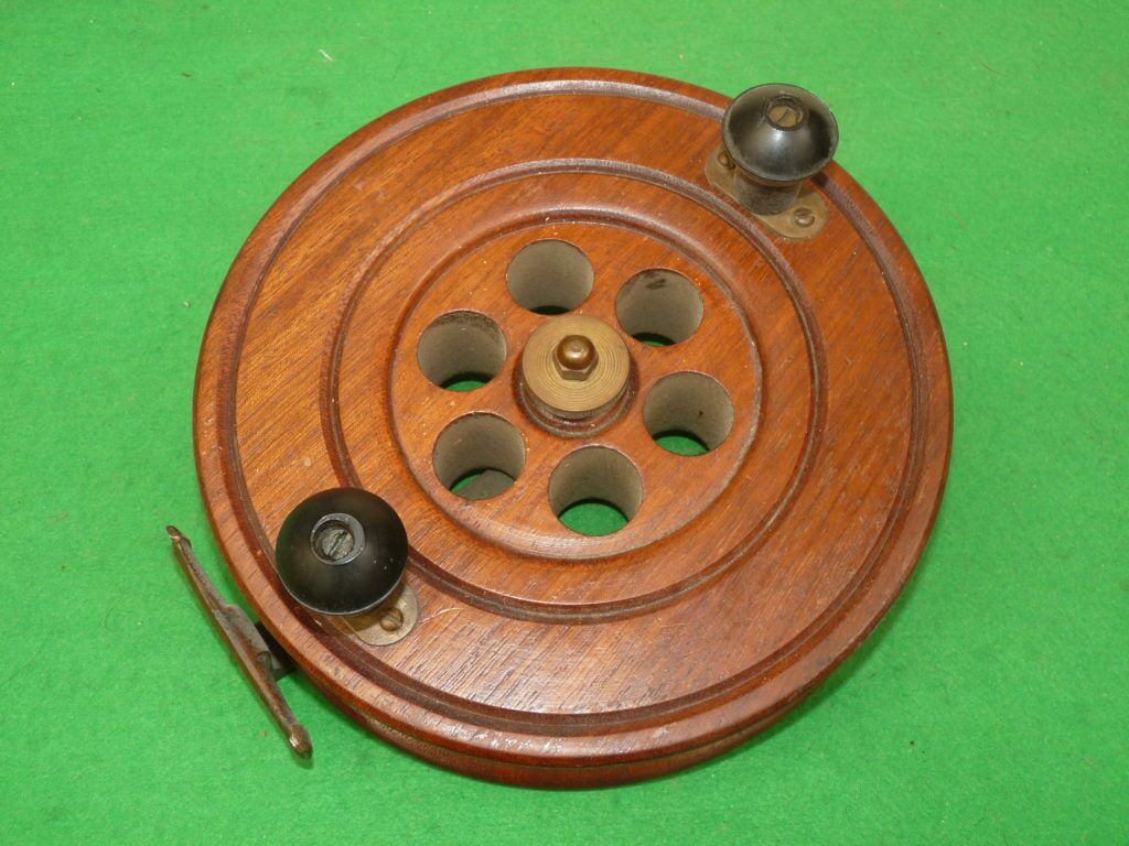 """An 8 ½"""" diameter English Wood and brass ScarbGoldugh Pattern reel"""