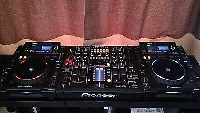 pioneer DJM 2000 mixer and 2 pioneer CDJ 2000 decks