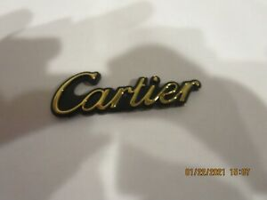 LINCOLN EMBLEM GOLD CARTIER WITH DOUBLE SIDED TAPE ATTACHMENT TO CAR BODY