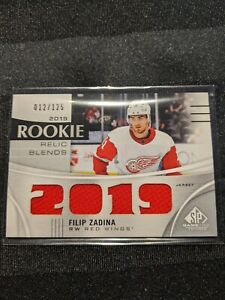 2019-20-SP-Game-Used-Rookie-Relic-Blends-034-2019-034-Jersey-012-125-Filip-Zadina