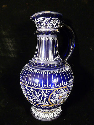 COBALT BLUE GLASS PITCHER W/ HAND PAINTED WHITE DECORATIVE ENAMELING CIRCA 1850