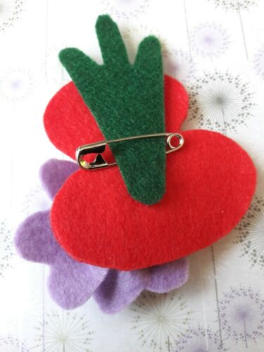 Traditional style red felt poppy brooch with smaller contemporary purple poppy.