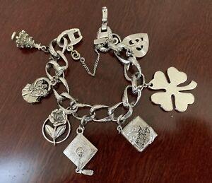 Vintage-Signed-Monet-Silver-tone-Charm-Bracelet-w-7-Moveable-Monet-Charms