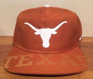 huge selection of 870b9 08a98 Image is loading Nike-University-Of-Texas-Longhorns-Dri-Fit-Snapback-