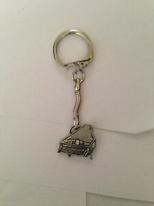 Rhino PP-A11 made of fine English Pewter on a snake keyring