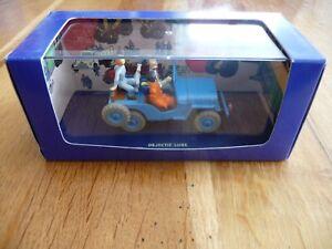"""Jeep """"Tintin"""" bleue neuve en boîte - France - État : Neuf: Objet neuf et intact, n'ayant jamais servi, non ouvert. Consulter l'annonce du vendeur pour avoir plus de détails. ... Type du véhicule: Jeep Échelle: 1:43 Objet modifié: Non Marque: Atlas Couleur dominante: Bleu Pays de fabrica - France"""