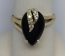 14KT YELLOW GOLD BLACK ONYX AND DIAMOND RING SIZE 7.25