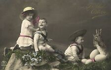 Easter children with eggs and bunny hare photo postcard Ca 1910's