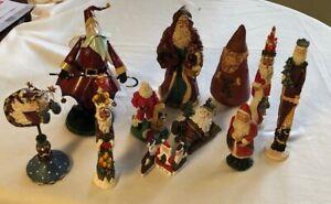 Lot of 11 Santa Claus Figurines, resin, metal, pottery, canvas. vintage/modern