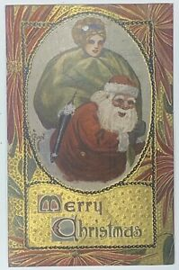 Old-Divided-Back-Christmas-Postcard-Santa-Claus-Carrying-Lady-Girl-Doll-On-Back