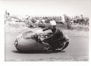 1955-Moto-Guzzi-dustbin-racer-at-speed-photo-REPRO