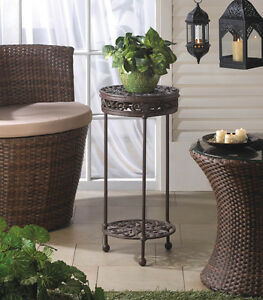 cast iron plant stand round brown two shelves decorative 24 1 8 tall. Black Bedroom Furniture Sets. Home Design Ideas