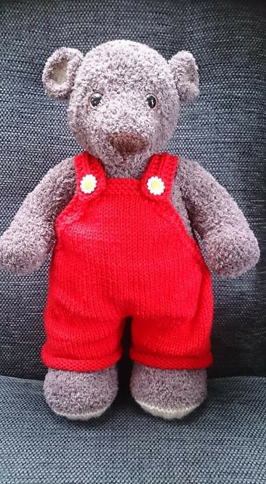 Soft teddy in red dungarees hand knitted