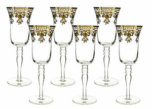 fine 10 oz champagne flutes with gold accented rim 8 inches tall 6