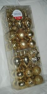 LOT-OF-74-GOLD-SHATTERPROOF-ORNAMENTS-VARIOUS-SIZES-SHAPES-PLUS-STRAND-OF-BEADS