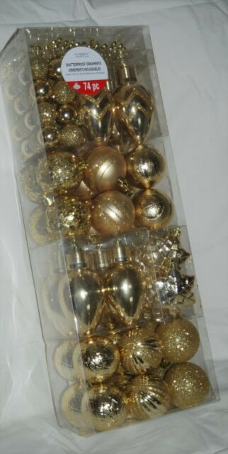 LOT OF 74 GOLD SHATTERPROOF ORNAMENTS VARIOUS SIZES SHAPES PLUS STRAND OF BEADS