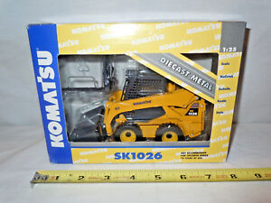 Komatsu-SK1026-Skid-Loader-With-Attachments-By-DCP-1-25th-Scale