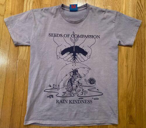 Online Ceramics T-Shirt - Seeds of Compassion Rain