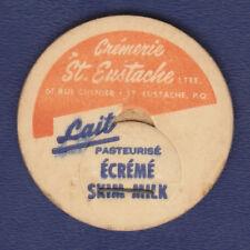 UNUSED SKIM MILK BOTTLE CAP (CREMERIE ST. EUSTACHE. QUEBEC, CANADA)