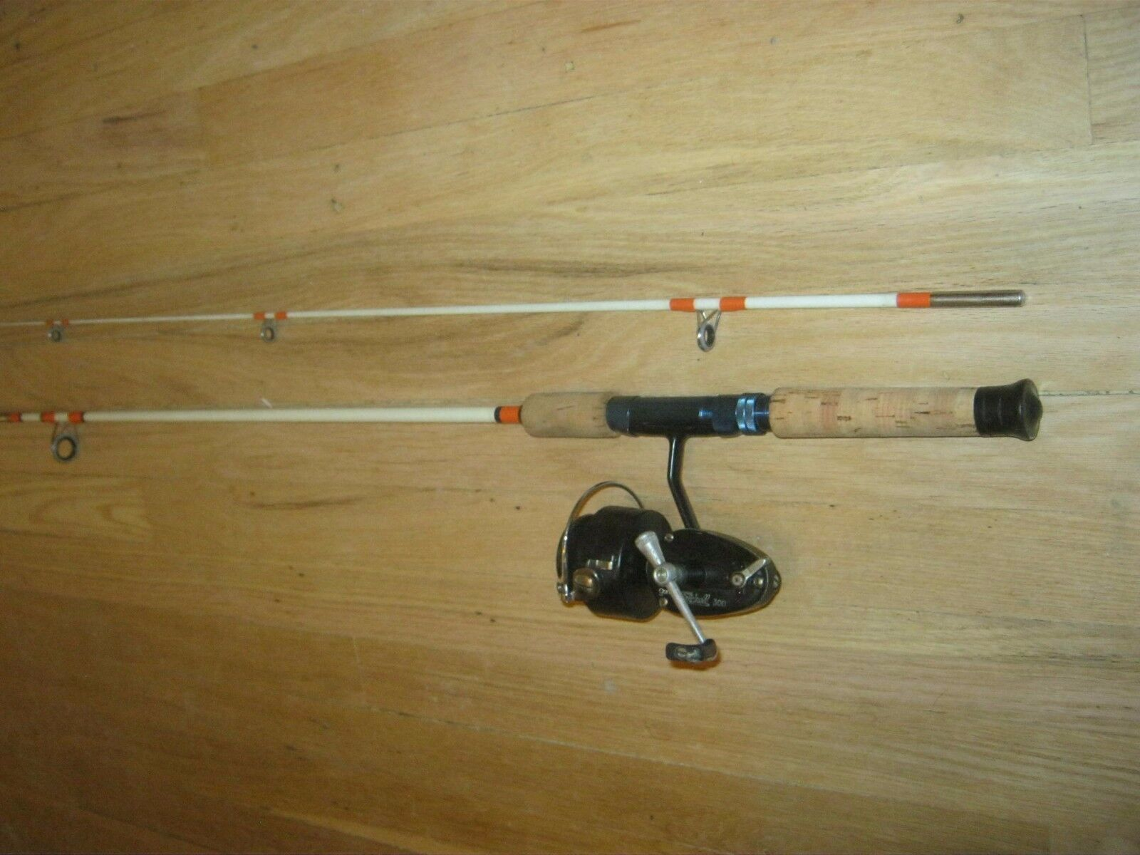 2pc. 6.5 ft spinning rod + Garcia Mitchell 300  reel  order now with big discount & free delivery