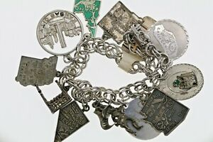 Vintage sterling silver charm bracelet with eleven charms