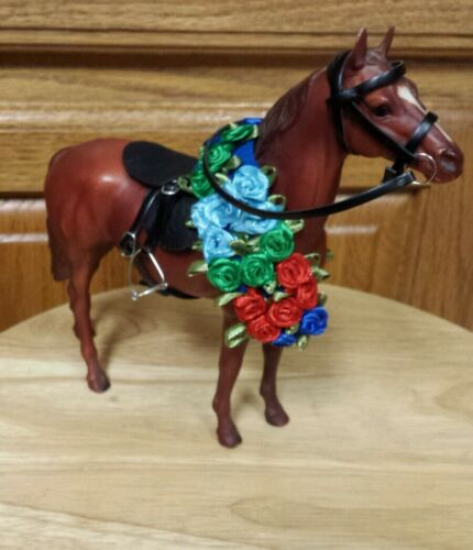 Breyer race horse Man O War with race saddle sey roses.New in Box