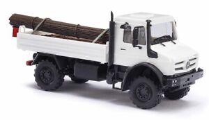 Busch-51011-Mercedes-Benz-U-5023-Flatbed-White-With-Steel-Cargo-H0