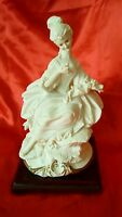 Capodimonte figurine by B Merli, Seated Lady with flowers