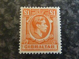 GIBRALTAR POSTAGE STAMP SG131 £1 ORANGE UN MOUNTED MINT