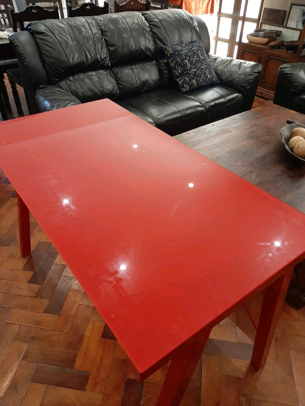 Modern RED DESK with a Glass Top and steel frame.
