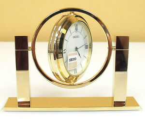 SEIKO GOLD TONE-SOLID BRASS TABLE CLOCK-ROTATING SPHERE QXG355GLH