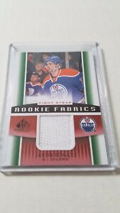 2013-14-SP-GAME-USED-ROOKIE-FABRICS-FIGHT-STRAP-JUSTIN-SCHULTZ-15-RARE-SP-RC