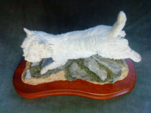 Terrier Dog figurine on wooden base signed Karen