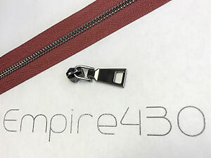 Continuous Zipper Chain by Feet Black Tape Metal #5 Gold Unfinished Zipper