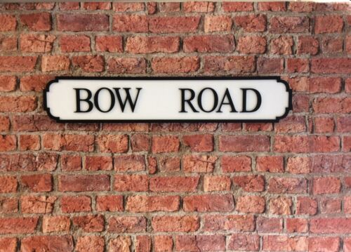 Vintage wood Street road Sign Bow Road