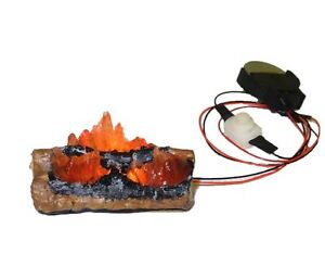The doll house miniature battery operated fire log set includes flaming log