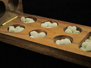 """Mini Kalaha 6.5""""x 3"""" wooden strategy board game with stones"""